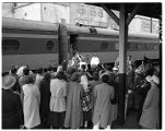 The varsity basketball team receives a welcome home at the Milwaukee Road's Tacoma passenger rail...