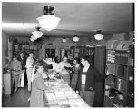 Schiffbauer waits on students in the Kittredge Hall bookstore, 1949