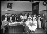 Cummins with students in a classroom on the Sixth and Sprague campus, 1912-1913